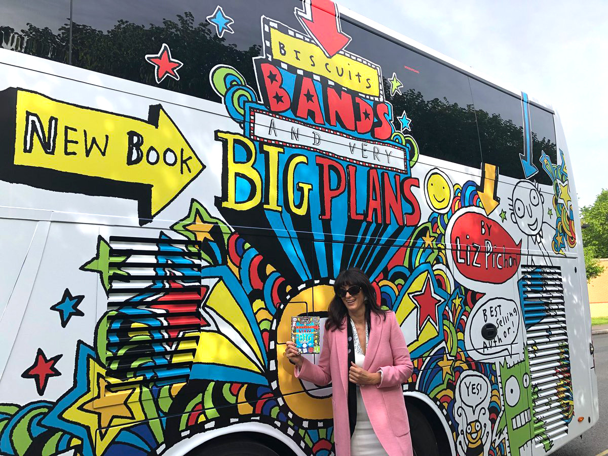 Liz is excited to see the Tom Gates Doodle Bus!